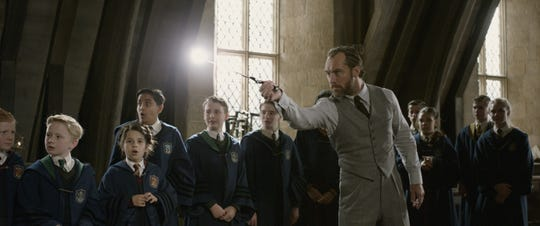"Albus Dumbledore (Jude Law) conjures some magic for his Hogwarts students in ""Fantastic Beasts: The Crimes of Grindelwald."""
