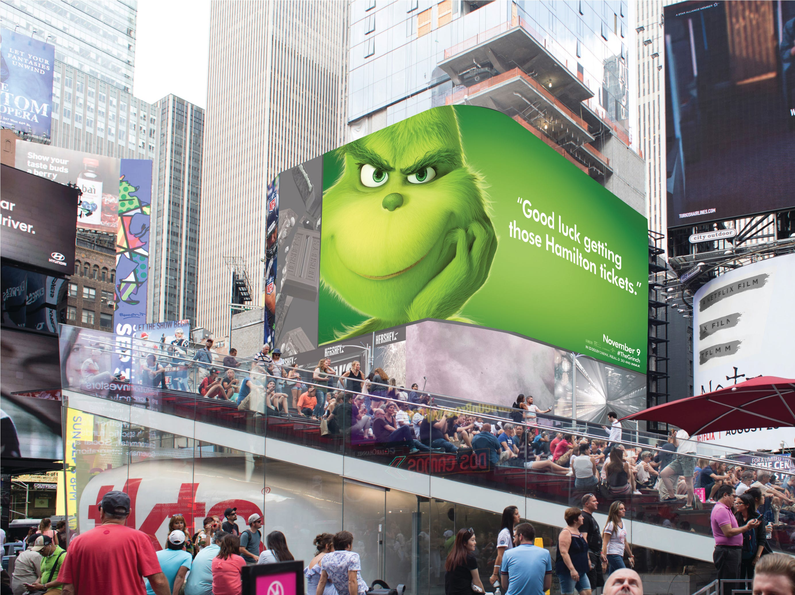 The Grinch laughs at patrons in line in Times Square hoping for tickets to the hottest show on Broadway.