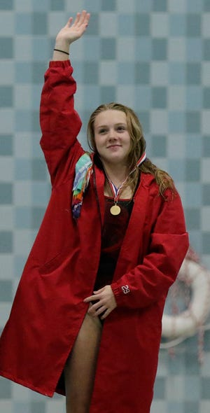 Neenah's Av Osero waves after winning her second Division 1 state diving title last season. She is seeded No. 1 this year as she goes for three in a row on Sautrday.