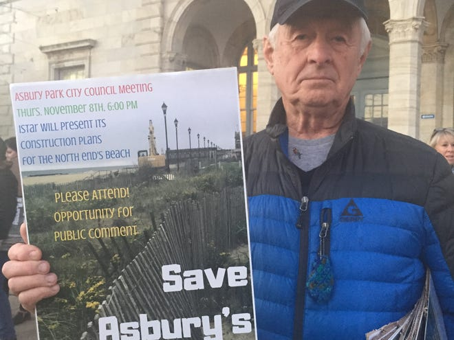 Asbury Park resident Tom Pavinski attends a rally to stop a boardwalk from being built at the city's north end section of the beach.