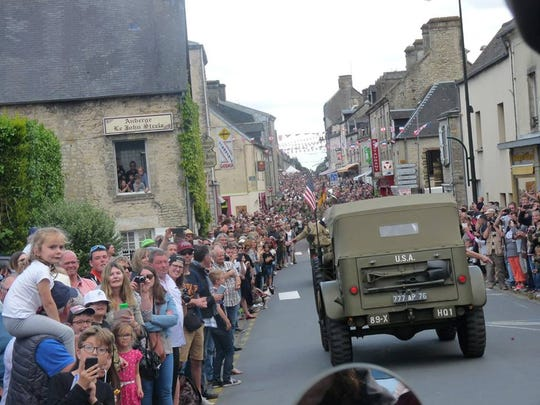 French residents line the streets to celebrate the D-Day anniversary in 2017.