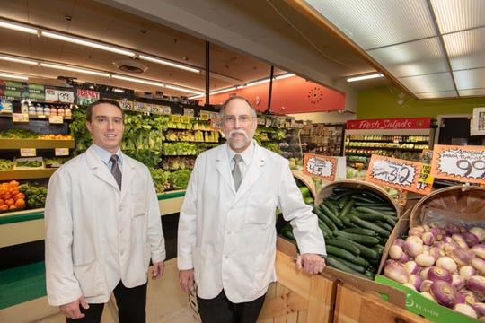 Tony Perri, right, owner of Fine Fare supermarket, stands with his son Michaelin their Long Branch store.