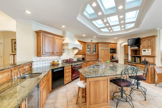 The remarkable kitchen features and granite stone island and beautifully crafted skylights.