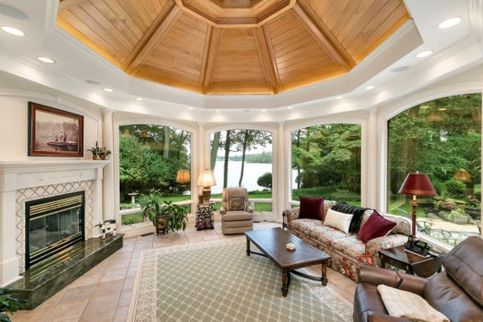 The family room offers an amazing ceiling decor with custom windows and recessed lights.
