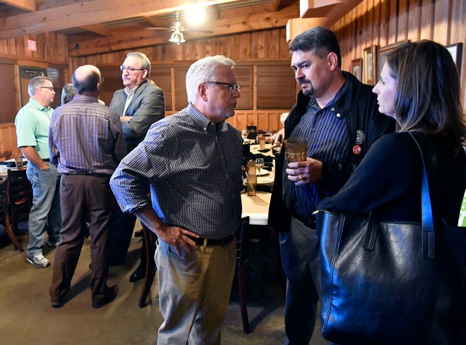 Abilene Independent School District spokesman Phil Ashby (center) speaks with Jay Lester, the district's executive director of Fine Arts, during the watch party for the $138.7 million bond on Election Night Tuesday Nov. 6, 2018. The bond passed.