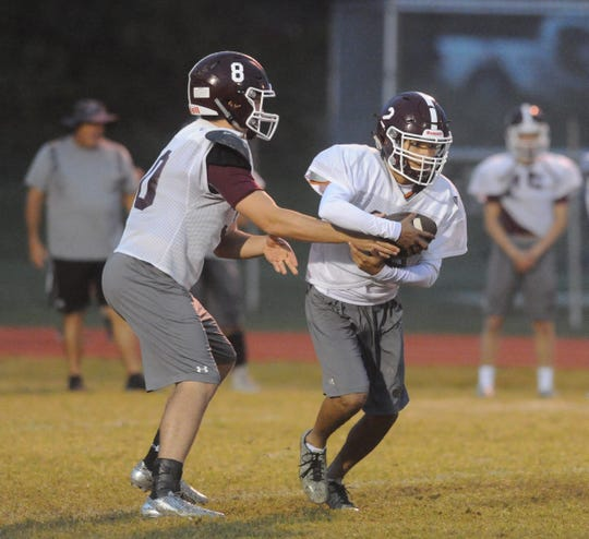 De Leon quarterback Kevin Yeager (8) hands off to running back  Jorge Gonzalez at practice Nov. 7, 2018.