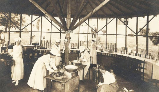 "Asheville Community Cannery, 1917. Local members of the National League for Women's Service established the cannery behind Buncombe County Courthouse. It ""produced 10,000 cans of vegetables in the summer of 1917 and an undetermined number in 1918,"" the N.C. Department of Natural and Cultural Resources states."