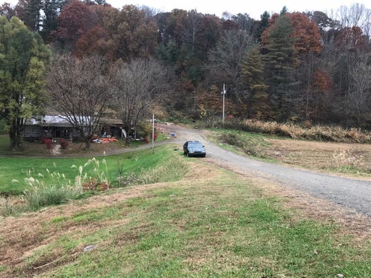 A view from NC 213 shows the site of a planned subdivision that could add 29 single family homes and nine duplex units to the western edge of Mars Hill. The log home currently on the property would remain, according to the developer.