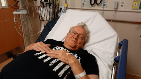 Sonny Pumphrey, of Maggie Valley, recovers in the hospital Tuesday, Nov. 6, after being attacked by a black bear in his driveway.
