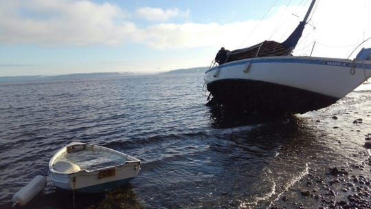 A 29-foot vessel was located at Skiff Point on Bainbridge Island Thursday morning and crews have been searching for a possible person in the water since then.