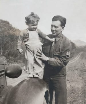 Army Staff Sgt. Alan Hunt balances his 20-month-old daughter, Victoria, on the fender of his vehicle in August 1943 near Fairbanks, Alaska. Hunt saw some action in the fighting for the Aleutians Islands, but his primary service was as a refrigeration engineer, installing refrigeration plants on military bases in Alaska. To see more photos from the Kitsap County Historical Society Museum archives, visit facebook.com/kitsaphistory, kitsapmuseum.org, or stop by the museum at 280 Fourth St. in Bremerton. Call 360-479-6226 for information.