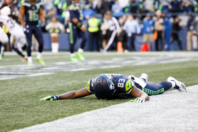 Seahawks wide receiver David Moore was disconsolate after he was unable to reel in a tipped pass in the end zone after time expired in Sunday's 25-17 loss to the Chargers.
