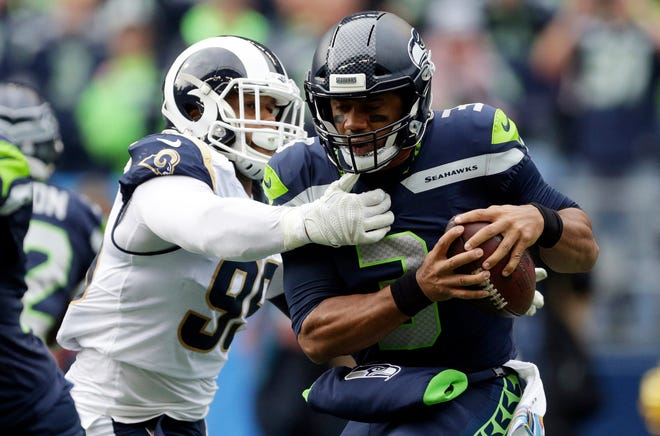 Rams tackle Aaron Donald sacks Seahawks quarterback Russell Wilson during an Oct. 7 game in Seattle. The Rams won that game, 33-31.