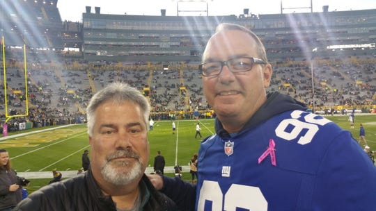 Chris Maloney, left, and Bill Mohr attend a game in Green Bay, Wisconsin on their quest to visit every NFL stadium. Lambeau Field was Maloney's favorite of the first 10 they visited.