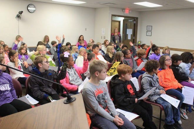 Black Mountain Primary School students raise their hands on Nov. 9, during Town Hall Day, when asked if they've visited Veterans Park. The students were one of two groups totaling over 120 who participated in the two-day introduction to local government.