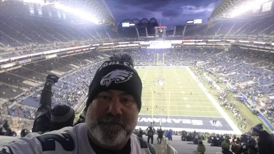 Chris Maloney takes a selfie from the Hawk's Nest in Seattle, the spot that inspired him and his friend Bill Mohr to try to visit every NFL stadium.
