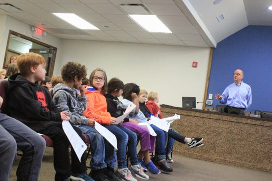 A group of third grade students from Black Mountain Primary School listen as assistant town manager and finance director Dean Luebbe explains the basics of local government. Over 120 students from the school participated in Town Hall Day on Nov. 8 and 9.