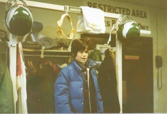 A young Chris Maloney stands at the locker of former Eagles quarterback Ron Jaworski in 1980.
