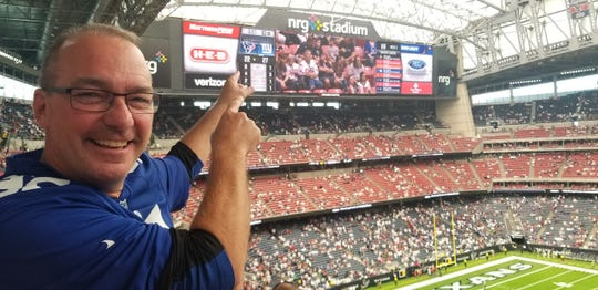 Bill Mohr points to the scoreboard as his Giants picked up a rare win this season in Houston.