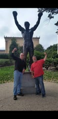 Chris Maloney, right, and Bill Mohr pose with the Rocky statue near the steps of the Philadelphia Museum of Art. Later the two would attend their first NFL game together.