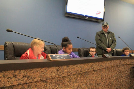 Black Mountain Primary School students participate in a mock aldermen meeting during Town Hall Day on Nov. 9 as mayor Don Collins looks on.