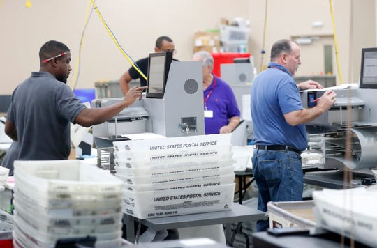 Staff in the office of Broward County Directorate will count ballot from the mid-time election, Thursday, November 8, 2018, in Lauderhill, Fla. (AP Photo / Wilfredo Lee)