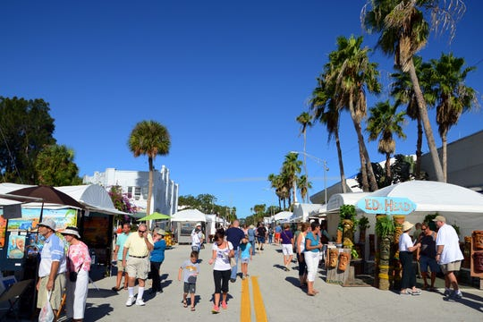 People wander the streets of the Eau Gallie Arts District during A PAST Artworks of Eau Gallie Fine Arts Festival.