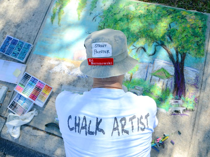 50d689f4 Ed Baranowski works on his chalk drawing during the 2013 Artworks of Eau  Gallie Fine Arts