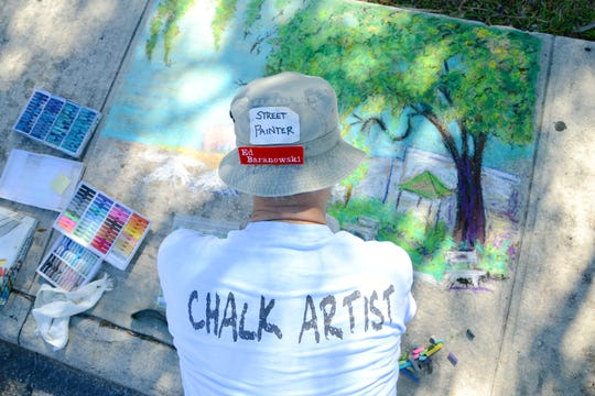 Ed Baranowski works on his chalk drawing during the 2013 Artworks of Eau Gallie Fine Arts Festival.