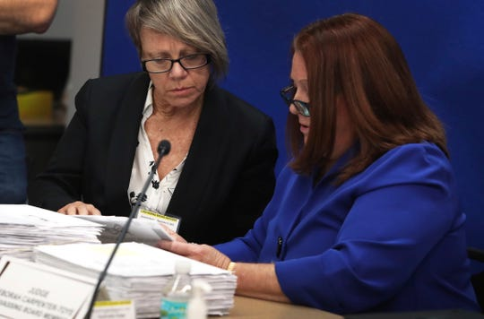 Canvassing Board members, Judge Betsy Benson, left, and Judge Deborah Carpenter-Toye look over signatures on ballots at the Broward County Supervisor of Elections in Lauderhill, Fla., Thursday, November 8, 2018. (Carline Jean/South Florida Sun-Sentinel via AP)
