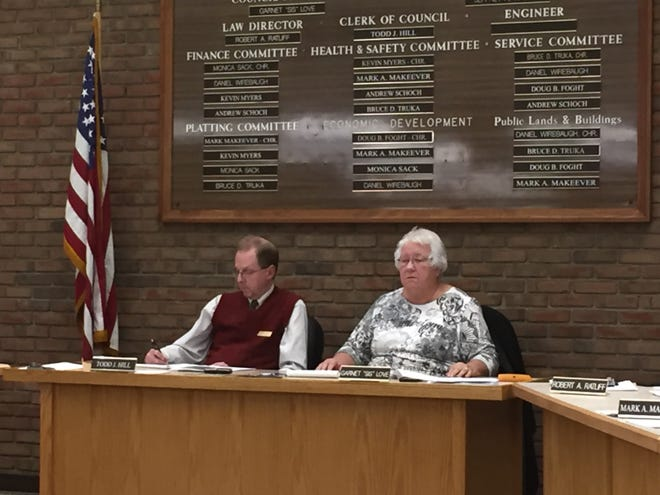Council president Sis Love and clerk of council Todd Hill listen at Thursday's joint regular committee meeting.