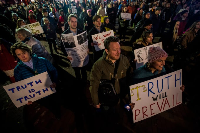 Hundreds marched through downtown Burlington, Vt., on Thursday night, Nov. 8, 2018, protesting the firing of U.S. Attorney General Jeff Sessions by President Trump.