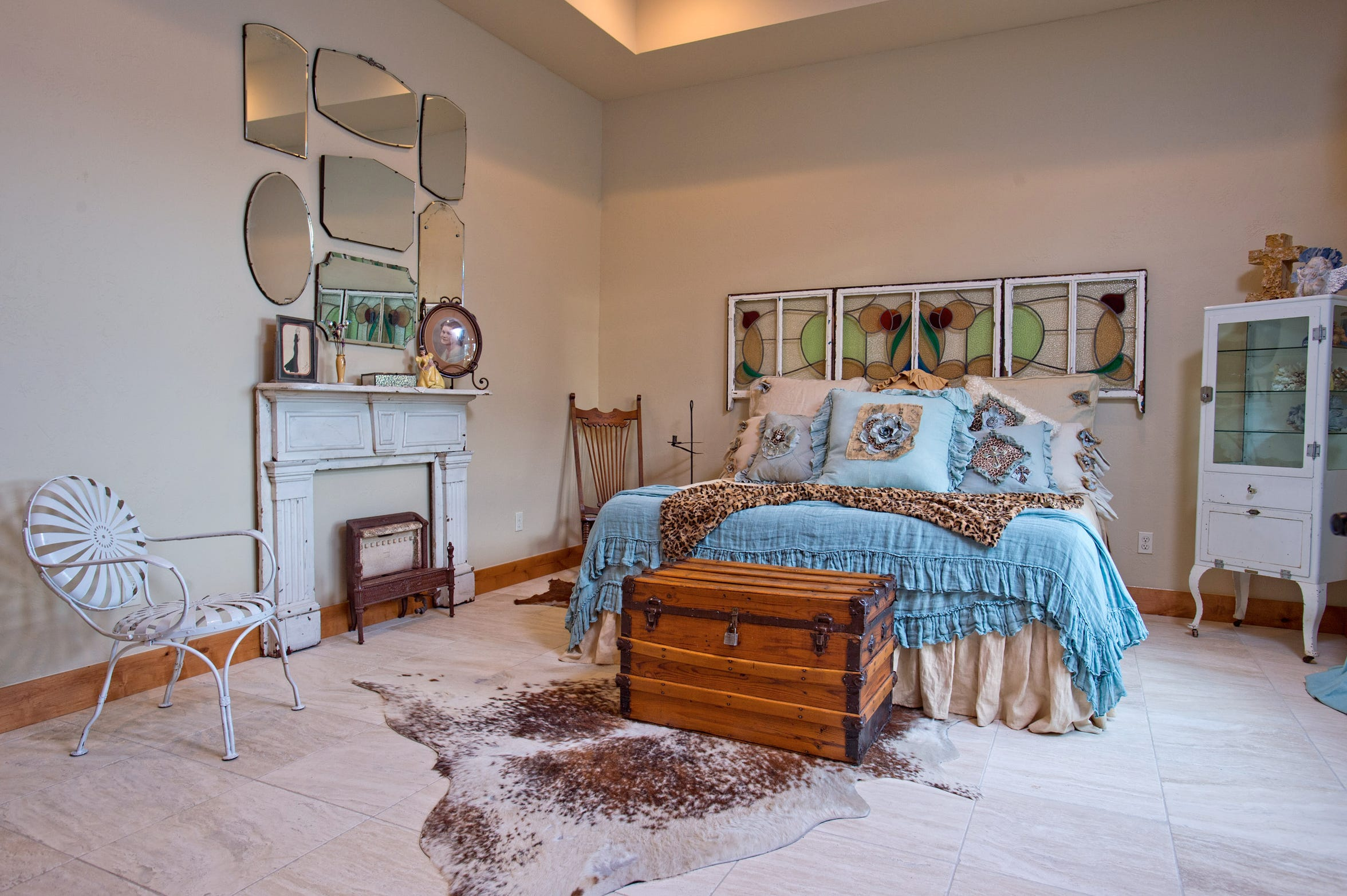 The eclectic tastes of the homeowners is evident in this antiques filled guest room
