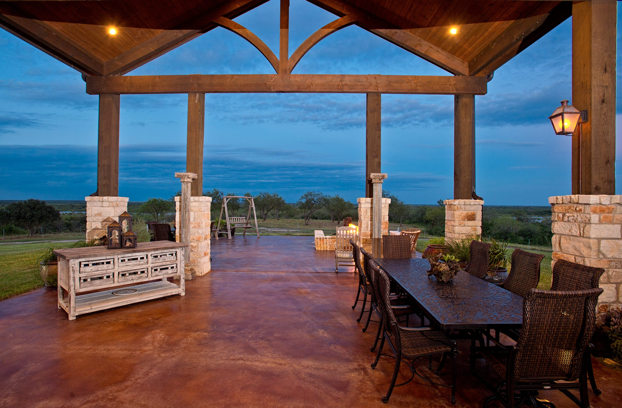 The roofline supported by heavy solid wood truss beams continues from the living space to the amazing outdoor living space overlooking the Nueces River and expansive acreage surrounding the home.
