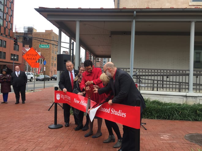 Rutgers-Camden officials cut the ribbon on the Artis Building, a renovated former dentist's office that will become home to the university's Childhood Studies program.
