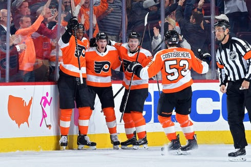 Dale Weise, second from left, scored the tying goal with 2:13 left. Shayne Gostisbehere won it in overtime.