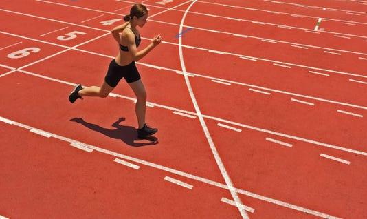 Female Model Running On Track