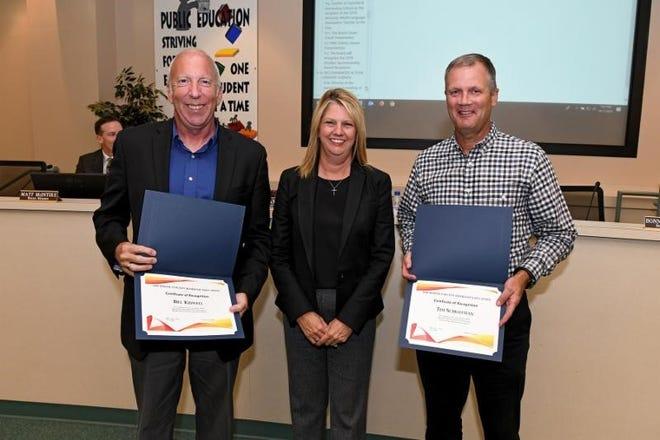 From left are Bill Kidwell, school board member Bonnie Rickert and Tim Schlotman.