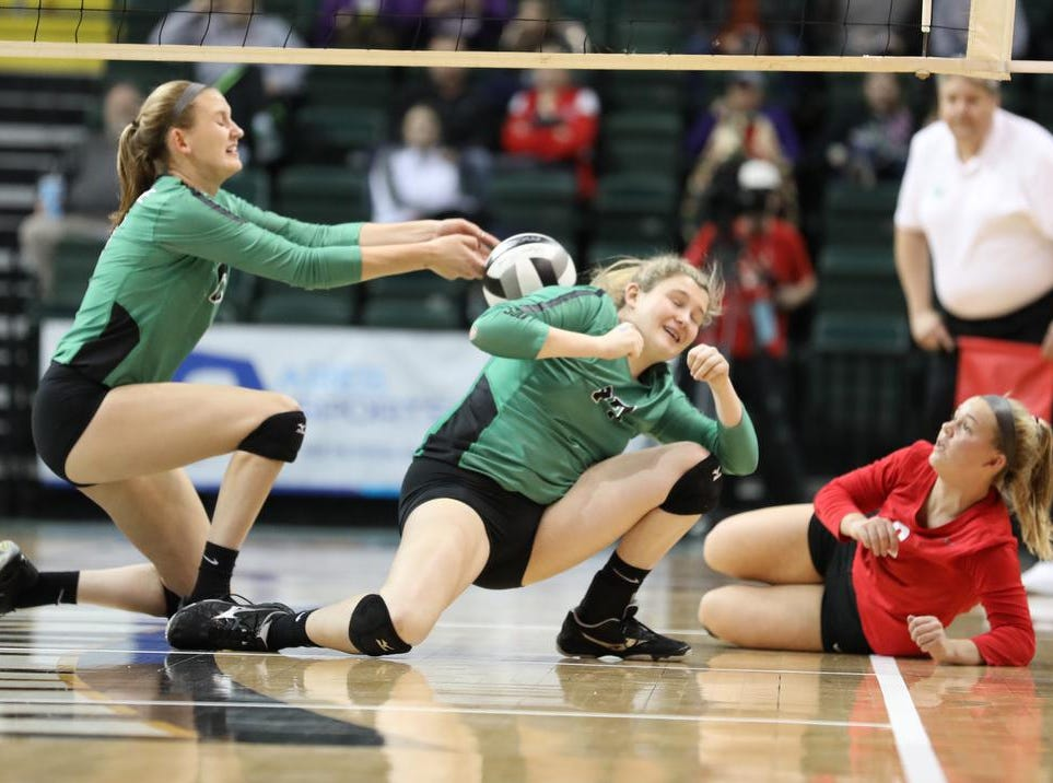 Ursuline players Julia Wilkins Katie Biel and Maggie Huber during the Lion State semi-final volleyball game against Olentangy Libery, Friday, Nov.9, 2018.
