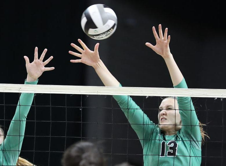 Ursuline players Logan Case and   Julia Wilkins  defend the net during the Lions State semi-final volleyball game against Olentangy Libery, Friday, Nov.9, 2018.
