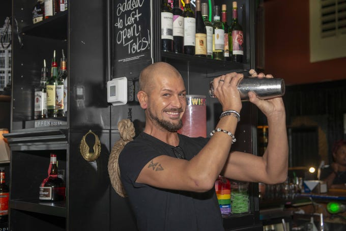 The Birdcage at 927 Race St. hosts their throwback party every Thursday night with a Studio 54 theme featuring music from the '70s '80s and '90s. Bartender Josh Morrill prepares one of the signature drinks called the Tucan Twister consisting of vodka, lemonade, oj, grenadine and a splash of Sprite.