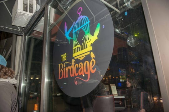 Signage for The Birdcage on Race St.