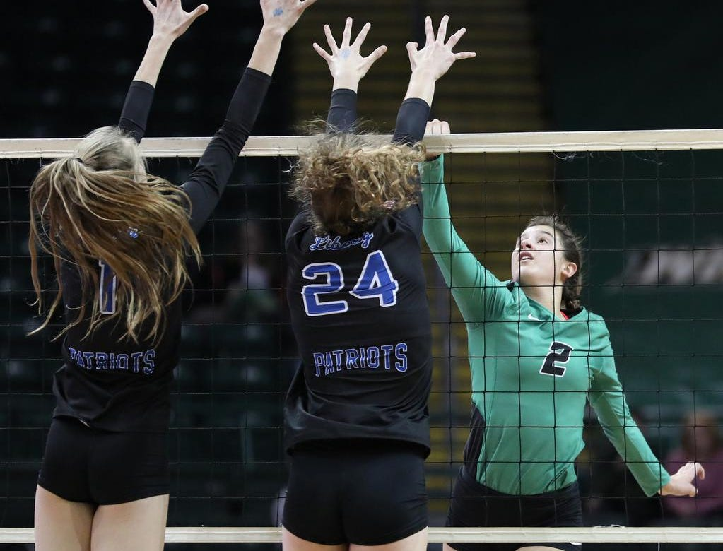 Ursuline player Peyton Breissinger (2) tries to get the ball past Olentangy Liberty players Claranne Fechter and Abby Erickson   during their  state semi-final volleyball game against Olentangy Libery, Friday, Nov.9, 2018.