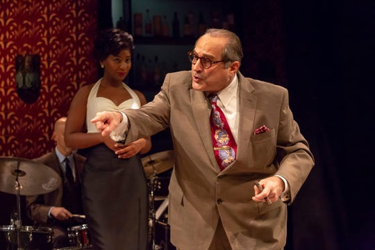 """Neal Benari plays Syd Nathan, the irascible founder and owner of Cincinnati-based King Records in the world premiere production of """"Cincinnati King,"""" running through Dec. 23 at the Playhouse in the Park. Behind him, you can see singer/actor Anita Welch, who plays nearly a dozen different roles in the course of the show."""