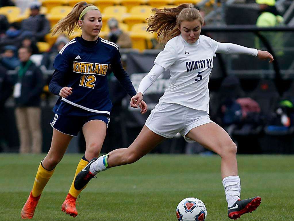 Cincinnati Country Day forward Lawson Renie drives to the goal in front of Kirtland defender Tea Petric during their Division III Championship soccer game at MAPFRE Stadium in Columbus Friday, Nov. 9, 2018.