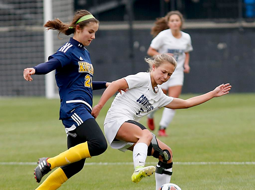 Cincinnati Country Day forward Joely Virzi controls the ball against Kirtland midfielder Jenna Sayle during their Division III Championship soccer game at MAPFRE Stadium in Columbus Friday, Nov. 9, 2018.