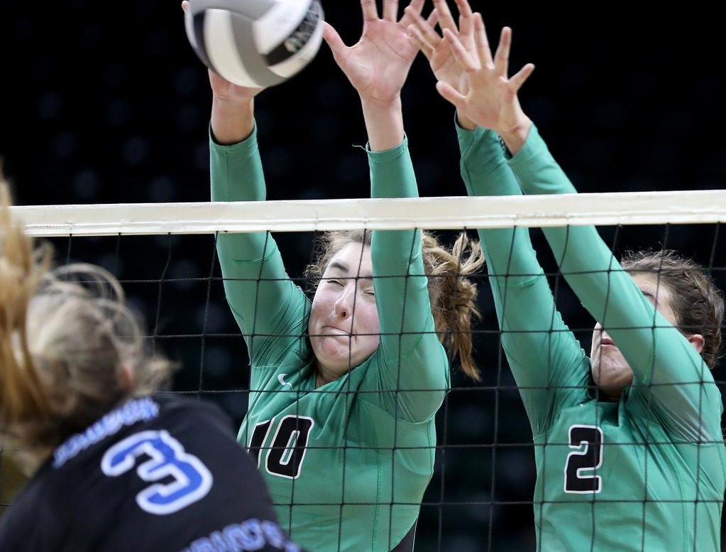 Ursuline players Julia Wilkins and Peyton Breissinger block a kill attempt by Olentangy Liberty player Grace Clark (3)  during their   State semi-final volleyball game , Friday, Nov.9, 2018.