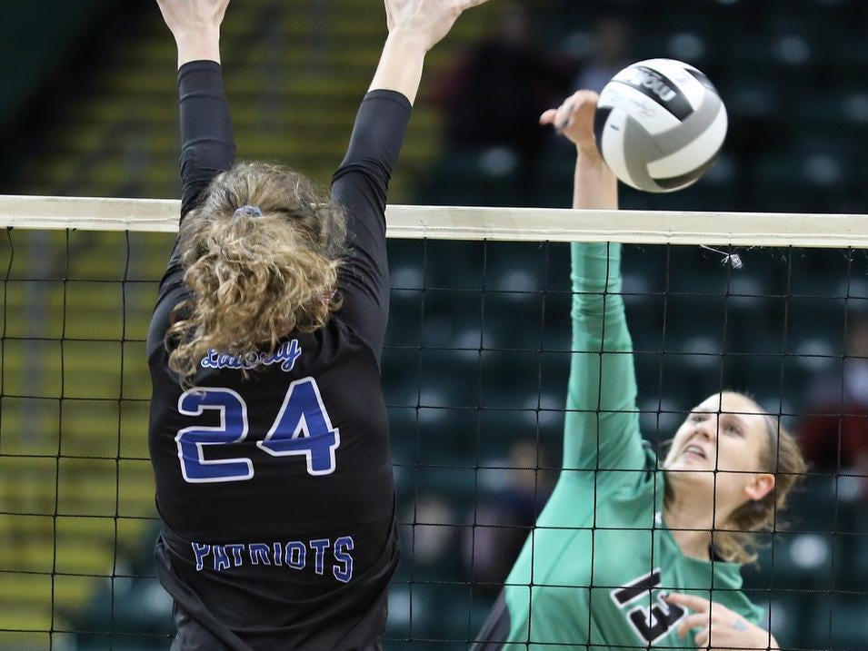 Ursuline player  Julia Wilkins tries a kill attempt against Olentangy Libery player  Abby Erickson (24) during their    State semi-final volleyball game  Friday, Nov.9, 2018.