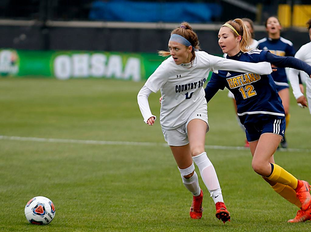 Cincinnati Country Day forward Kate Brock holds off Kirtland defender Tea Petric during their Division III Championship soccer game at MAPFRE Stadium in Columbus Friday, Nov. 9, 2018.