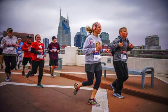 Runners participating in the recent Nashville Wounded Warrior Project Carry Forward 5K, sponsored by CSX.